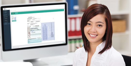 Pharmacist at Computer Using ScanStoreRx